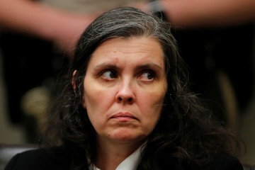 Louise Turpin looks over towards the judge as she appears with her husband in court in Riverside, California