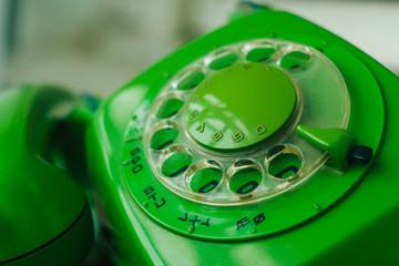 close up green retro rotary telephone
