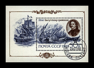 Peter the Great (aka Peter Alexeyevich, Peter I) and Battle of Gangut scene (July 1714), 275th anniversary, circa 1989. canceled stamp printed in the USSR (Soviet Union) isolated on black background.