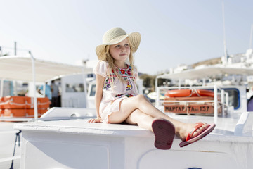 Portrait of girl, sitting on boat
