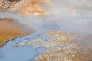 Geothermal Puddles with Steam in Iceland