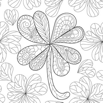 Coloring book clover, shamrock on St. Patrick's Day for adults. Isolated pattern. Hand drawn vector sign luck. Anti stress seamless ethnic bohemian background. Vintage decorative element.Indian motifs