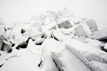 Tourist in the wild. Snow storm, despair. Lost his way.      Ural winter landscape with giant frozen stone cliffs-buttes on a highland plateau.Russia in winter
