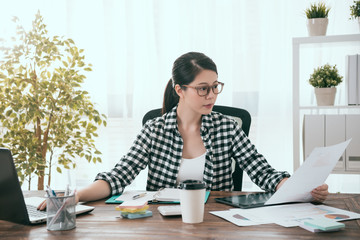 attractive business woman using mobile computer