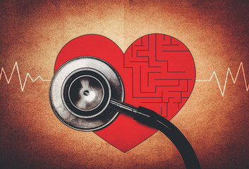 maze in heart symbol with stethoscope