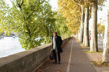 Attractive Arabian journalist walking near Seine.