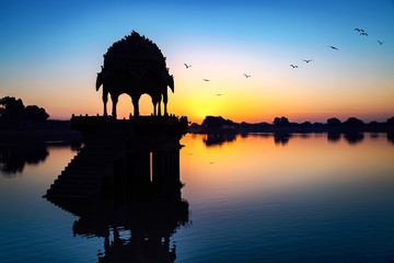 Wall Mural - Gadi Sagar lake (Gadisar) at Jaisalmer, Rajasthan with ancient temple at dawn.