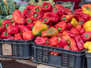 Red peppers on sale aon stand at farmer's market