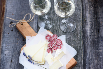 Cheese plate on a wooden background.