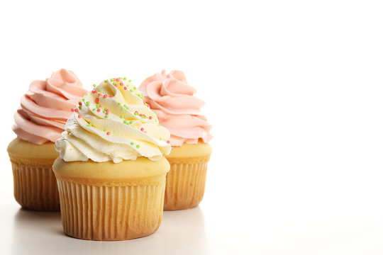 Cupcakes with cream isolated on white