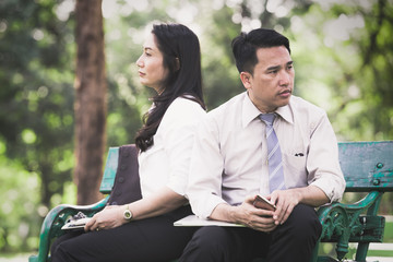 Asian business couple reconcile in the park,Business couple concept