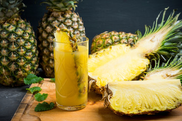 Glass of pineapple juice on the rustic background. Selective focus.