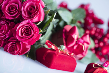Valentines day concept background. Roses, gifts, romantic decorations. Place for text.