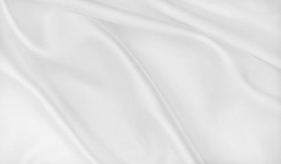 Smooth elegant white silk or satin luxury cloth texture as wedding background. Luxurious Christmas background or New Year background design