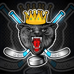 Beast wolf face from the front view with hockey puck, crown and crossed stick. Logo for any sport team timberwolf
