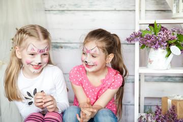 Cute little girls in spring studio