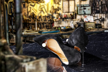 woman handmade shoes and workspace background