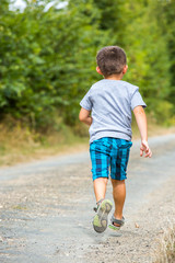 child running along a country road
