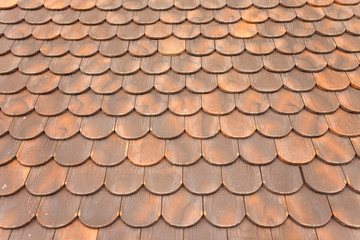 detail of  a tiled roof from a mountain house in Val di Funes (Italy)