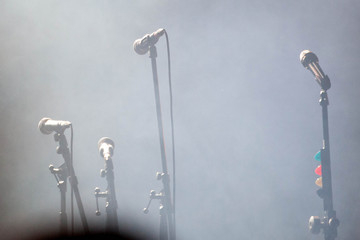 microphones standing on the stage - concert