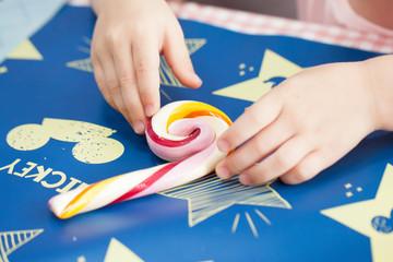 child making lollipops by hand - fun , childchood
