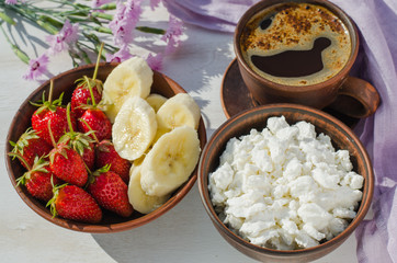 Healthy breakfast, cottage cheese with fruit.