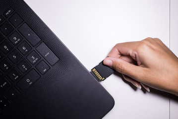 Hand removable  memory card into laptop computer with usb slot