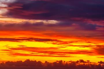 Fiery orange sunrise sky.