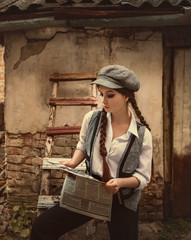Retro hooligan reads the newspaper. Vintage businesswoman. A woman is dressed like a man, a vintage style. Times of the Great Depression