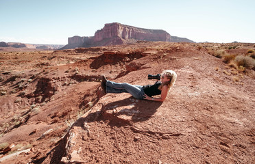 woman trying to make photos in Monument Valley.