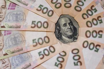 Dollars and hryvnia closeup