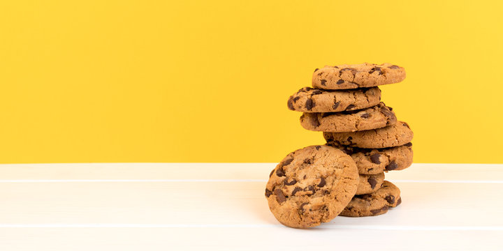 cookies with yellow background and copy space panorama