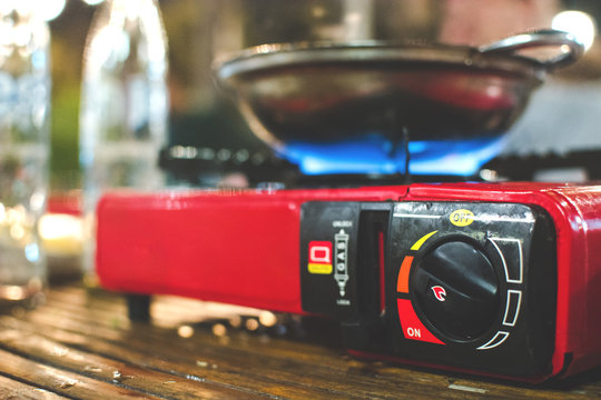 Portable gas stove and a frying pan in the camp