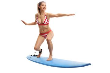Young woman in bikini surfing