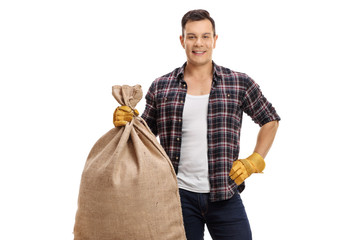 Young farmer holding a burlap sack