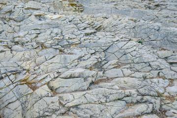 Arrière-plan nature, texture de rocher, pierre gris.