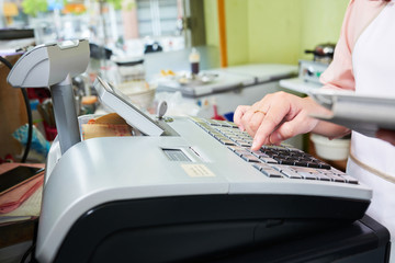 Working at cash desk