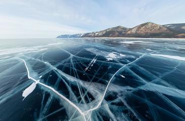 Panorama cracks on blue ice of Lake Baikal from Olkhon