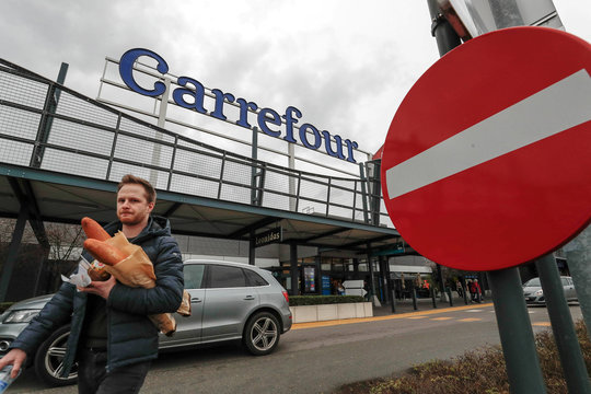 The logo of Carrefour is seen on the roof of a shopping center in Drogenbos