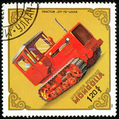 Ukraine - circa 2018: A postage stamp printed in Mongolia show Tractor Dt-75, USSR. Series: Tractors. Circa 1982.