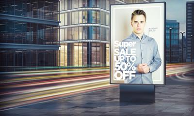 Advertising fashion sale billboard in city night Wall mural