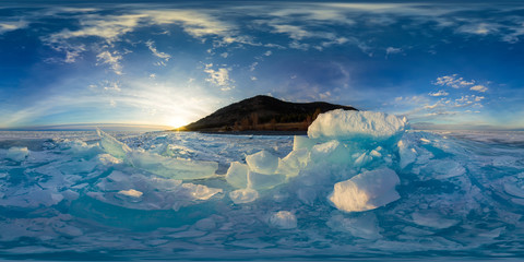 Woman in blue hummocks of the ice Baikal at sunset. Spherical vr 360 180 degrees panorama
