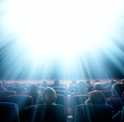 viewers look at shining light in the cinema