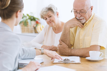 Senior people signing life insurance