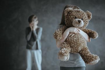 Kid holding teddy bear