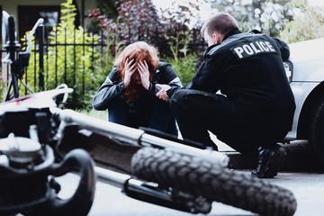 Policeman interrogating a motorcyclist