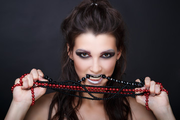 Girl biting beads