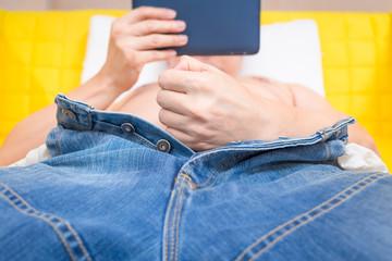 man make a masturbation during watching online porn, pornographic film movie in smartphone on bed