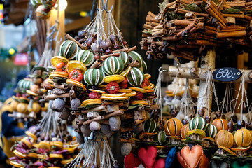 Traditional dried orange and cinnamon stick Christmas decorations on a market stall