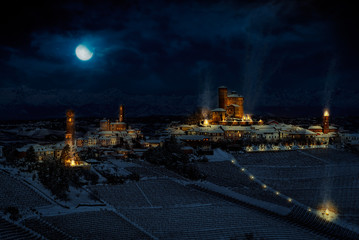 Fantasy photomanipulation of medieval landscape in winter on night with castle and cities